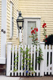 Colonial house entrance. Colonial house entranve with front fence and small garden royalty free stock photos