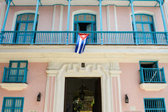 Colonial house facade with cuban flag. Pink colonial house, in Old Havana royalty free stock images