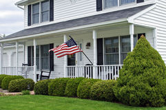 Colonial House. White two story colonial house with American flag Stock Photos