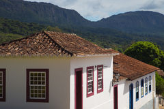Colonial houses of Tiradentes, Brazil. Landscape of Tiradentes displaying typical colonial portuguese houses and the mountains Stock Photo