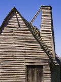 Colonial Hut. Reproduction of a 17th century English hut with chimney at Plimoth Plantation, Massachusetts, USA Stock Photography