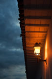 Colonial Light. A colonial roof and light taken at dusk Royalty Free Stock Photography