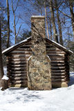 Colonial Log Cabin In Snow Stock Photo