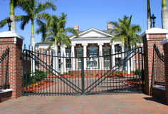 Colonial Mansion. Brick colonial mansion with white columns and tall palm trees royalty free stock photo