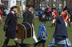 Colonial Men Carrying a Chest Royalty Free Stock Photography