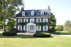 Colonial red brick house Stock Image