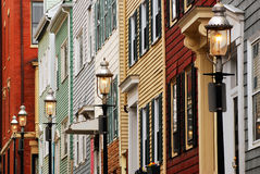 Colonial row Houses. Street lights come on in a row of Colonial homes in Charlestown, MA stock photography