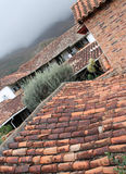 Colonial rustic roofs Stock Photo