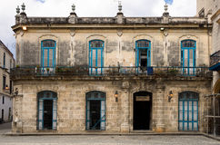 Colonial Spanish buildings in Havana, Cuba. An old Colonial Spanish building in Havana Cuba. Blue framed doors, two storied  stone construction Stock Photo