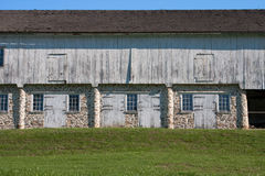 Colonial stone and wood horse stables Stock Photography