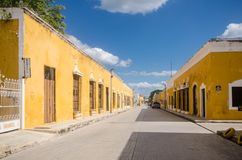 Colonial street and houses of Izamal magic town at Mexico royalty free stock image