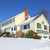 Colonial style house in winter Royalty Free Stock Photos