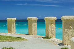 colonial  style stone posts on a cliff edge ocean  Stock Image