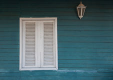 Colonial style. White window on wooden wall. Stock Photography