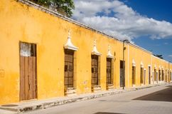 Colonial street and houses of Izamal magic town at Mexico stock photos