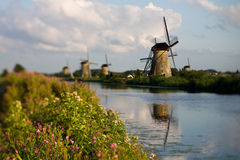 Colonial view. Netherlands - group of wind mills - travel symbols stock photos