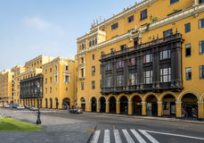 Colonial Yellow Building with Balconies in downtown Lima city near Plaza Mayor - Lima, Peru Stock Photos