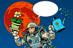 Colonization Mars astronaut plants irrigation. Pop art retro style. Ecology and science. Agriculture and desert. Man astronaut Stock Photos