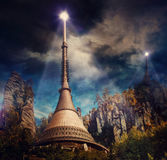 Colonization station. Futuristic colonization station on planet. High towers in rough rocks with bright lights on top Stock Images