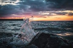 Colonna di acqua su un fondo di tramonto Fotografia Stock Libera da Diritti