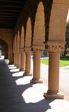 Colonnade. Arches, archway, hallway, hall, spanish, architecture, tiled, floor, portico, sun, shadows, columns Stock Photography