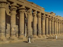 A colonnade of ancient Egyptian columns at Philae Temple royalty free stock photo