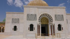 Colonnade with arches and entrance to mausoleum Habib Bourguiba in Monastir city Tunisia. Dolly shot. Colonnade with arches and main entrance to mausoleum stock footage