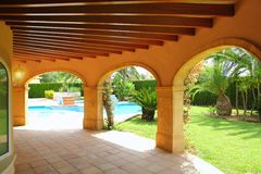 Colonnade archs house swimming pool garden Royalty Free Stock Images