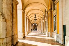 Colonnade and archways by the Commercial Square, Lisbon. Royalty Free Stock Photos