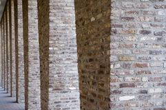 Colonnade. Columns constructed with bricks standing in a row Stock Photos