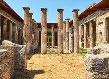 Ruins of Pompeii, ancient Roman city. Pompei, Campania. Italy. Colonnade in courtyard of Domus Pompei in Via della Abbondanza at Ruins of Pompeii. The city was Royalty Free Stock Photos