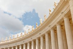 Colonnade crowned by statues. St. Peter`s Square. Vatican City stock photo