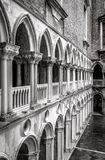 Colonnade of the Doge`s Palace courtyard, Venice, Italy. Doge`s Palace or Palazzo Ducale is one of the main tourist attractions in Venice. Renaissance Stock Photos
