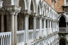 Colonnade of the Doge`s Palace courtyard, Venice, Italy. Doge`s Palace or Palazzo Ducale is one of the main tourist destinations in Venice. Renaissance Royalty Free Stock Image