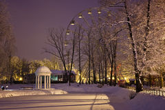 Colonnade and ferris wheel in Yunost park Royalty Free Stock Photo