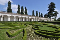 Colonnade in Flower Garden Stock Images