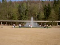 Colonnade of Luhacovice spa, fountain, people, forest and trees in the background royalty free stock images