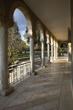 The colonnade in monastic to a garden Royalty Free Stock Photos