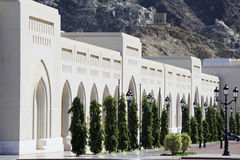 The Colonnade, mountains and watchtower in Old Muscat Stock Images
