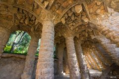 Colonnade of park Guell in Barcelona. Stone carved columns in colonnade of Park Guell, designed by Gaudi, Barcelona, Catalonia, Spain. Architectural details Royalty Free Stock Photos