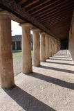 Colonnade Pompeano. Architecture of ancient building dating back to the ancient Romans found in the archaeological excavations of Pompeii site of so much tourism Stock Image