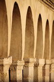 Colonnade in Saint Francis Square of Assisi. Italy Stock Photo