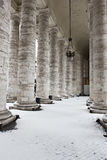 Colonnade with snow in St. Peter's Basilica. Stock Image