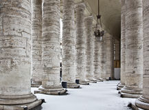 Colonnade with snow in St. Peter's Basilica. The columns are surrounding Saint Peter's Square (Piazza San Pietro), Vatican (Rome, Italy Royalty Free Stock Photography