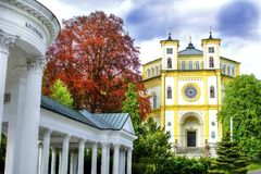 Colonnade of spring Karolina and catholic church in Marianske Lazne Stock Photography