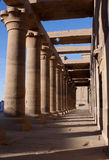 The colonnade of Temple of Isis. A photograph of the eastern colonnade of the temple of Isis, leading towards the first pylon stock photo