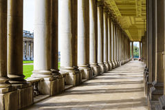 Colonnade in University of Greenwich. Colonnade and shadow in Old Royal Naval College, University of Greenwich, London royalty free stock photography