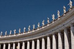 Colonnade in Vatican. Many ancient beautiful sculptures on colonnade in Vatican City Italy Stock Images