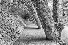 Colonnaded pathway in Park Guell, Barcelona, Catalonia, Spain. Colonnaded pathway made with masonry arcades in Park Guell, Barcelona, Catalonia, Spain Stock Photo