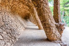 Colonnaded pathway in Park Guell, Barcelona, Catalonia, Spain. Colonnaded pathway made with masonry arcades in Park Guell, Barcelona, Catalonia, Spain Royalty Free Stock Photo